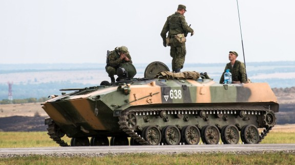 Russian soldiers talks to each other on the top of a tank, some 10 km outside the southern-Russian city of Donetsk, on August 18, 2014.