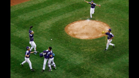South Korea players celebrate after defeating Japan 12-3 on August 23.