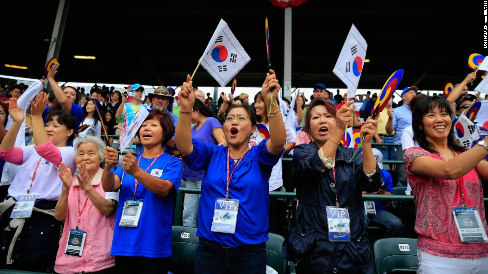 Fans of the South Korean squad cheer between innings on August 23.