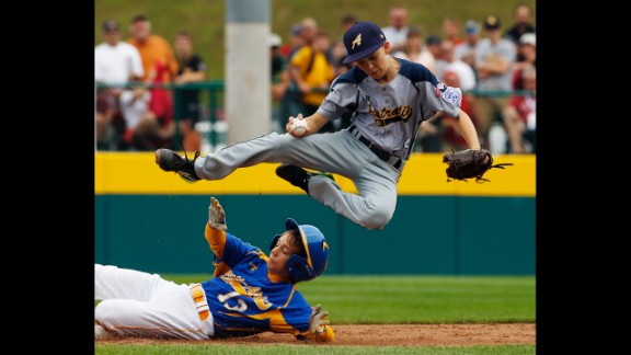 Australia's Calvin Eissens is sent flying after forcing out Czech Republic's Marek Krejcirik at second base during the third inning on Saturday, August 16.
