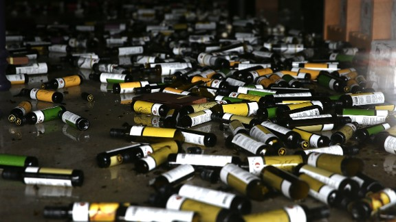 Bottles of olive oil and vinegar lie on the floor of a damaged business on August 24 in Napa.