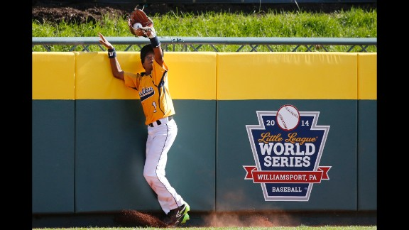 Chicago center fielder DJ Butler catches a ball by South Korea's Jae Yeong-hwang at the wall on August 24.