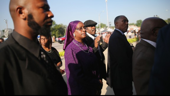 Mourners wait in line to enter the church.