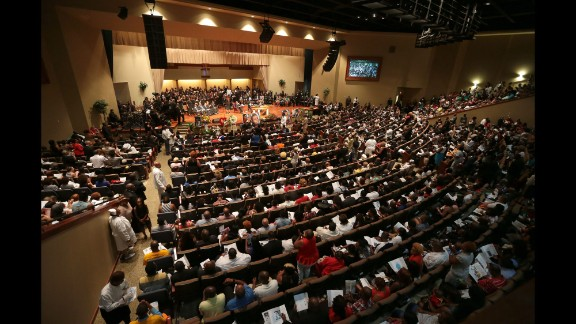 Mourners fill the pews for the funeral service at Friendly Temple Missionary Baptist Church in St. Louis.