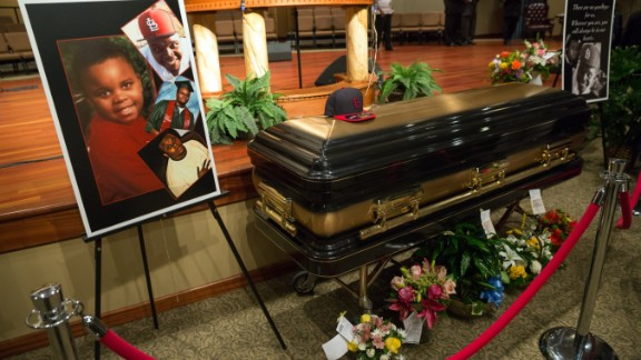 ST. LOUIS, MO - AUGUST 25:  Photos surround the casket of Michael Brown inside Friendly Temple Missionary Baptist Church awaiting the start of his funeral on August 25, 2014 in St. Louis Missouri. Michael Brown,18 year-old unarmed teenager, was shot and killed by a  Ferguson Police Officer Darren Wilson in the nearby town of Ferguson, Missouri on August 9. His death caused several days of violent protests along with rioting and looting in Ferguson.  (Photo by Richard Perry/Pool/Getty Images)