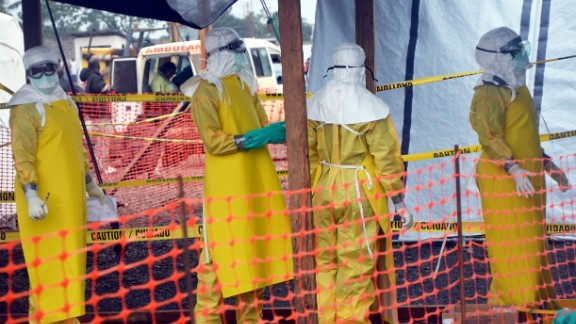 """A picture taken on August 21, 2014 shows French NGO Medecins Sans Frontieres (MSF - Doctors Without Borders) staff members standing wearing protective gear at the MSF ELWA hospital in Monrovia, where patients suffering from Ebola are taken care of. The United Nations vowed on August 23 to play a """"strong role"""" in helping Liberia and its neighbours fight a deadly outbreak of Ebola in west Africa, which it said could take months to bring it under control. Liberia has been particularly hard hit by the epidemic that has swept relentlessly across the region since March, accounting for almost half of the 1,427 deaths. AFP PHOTO / ZOOM DOSSOZOOM DOSSO/AFP/Getty Images"""