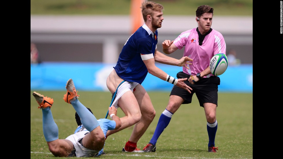 Juan Ignacio Conil Vila of Argentina pulls down the shorts of Faraj Fartass of France during a Rugby Sevens Final match at the 2014 Nanjing Youth Olympic Games in Nanjing, China, on Wednesday, August 20. France scored three late tries to win 45-22.