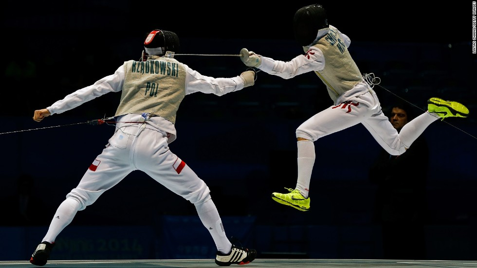 Chun Yin Ryan Choi of Hong Kong, left, and Andrzej Rzadkowski of Poland compete in the foil individual gold medal bout on Day 3 of the 2014 Summer Youth Olympic Games in Nanjing, China, on Tuesday, August 19.