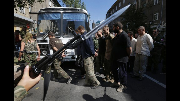 Pro-Russian rebels escort captured Ukrainian soldiers in a central square in Donetsk on Sunday, August 24.