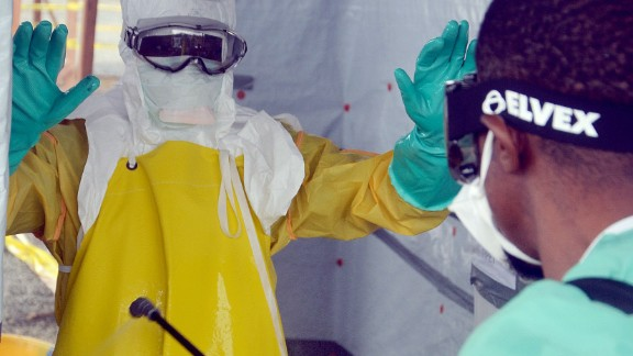 This picture from August shows a nurse disinfecting a doctor