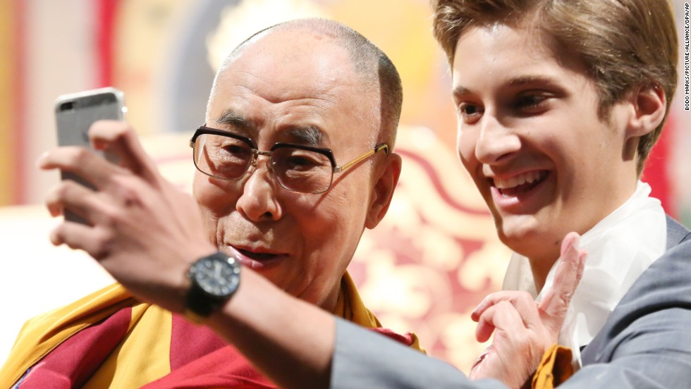 "Mattäus Uitz, right, takes a selfie with the Dalai Lama, spiritual leader of the Tibetans, during the event ""Mastering life through mental training"" at the CCH in Hamburg, Germany, on August 24. The Dalai Lama held speeches on human values and gave Buddhist advice from August 23 until August 26 at the Congress Centrum Hamburg."