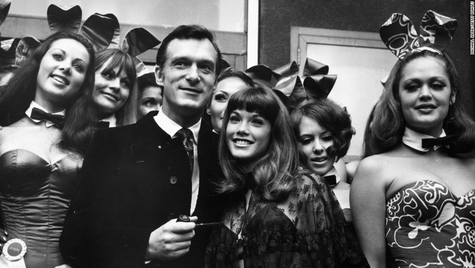 Playboy chief Hugh Hefner poses with English 'Bunny Girls' at his London Playboy Club. The iconic uniform of Playboy Club waitresses includes a white collar and black bow tie -- and not a lot else.