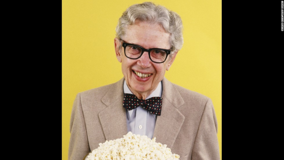 Popcorn king Orville Redenbacher playfully poses with a big bowl of popcorn in 1986. His bow-tied, bespectacled image graces packages of his product.