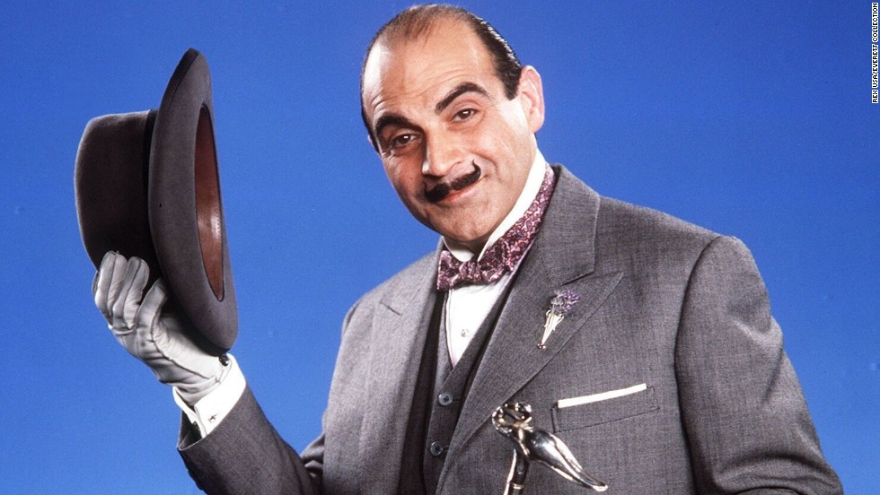 "David Suchet plays the French detective Hercule Poirot, originally created by author Agatha Christie, in television's ""Poirot."" His fancy accessories typically include a hat, bow tie and pince-nez eyeglasses. A pointy handlebar mustache finishes the look."