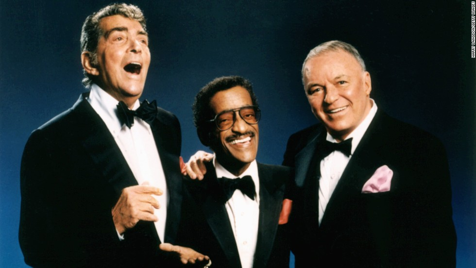 "Singers and actors Dean Martin, Sammy Davis Jr. and Frank Sinatra, members of the Hollywood ""Rat Pack,"" pose for a portrait circa 1988. These guys were always sharp as a tack, tux or no tux."