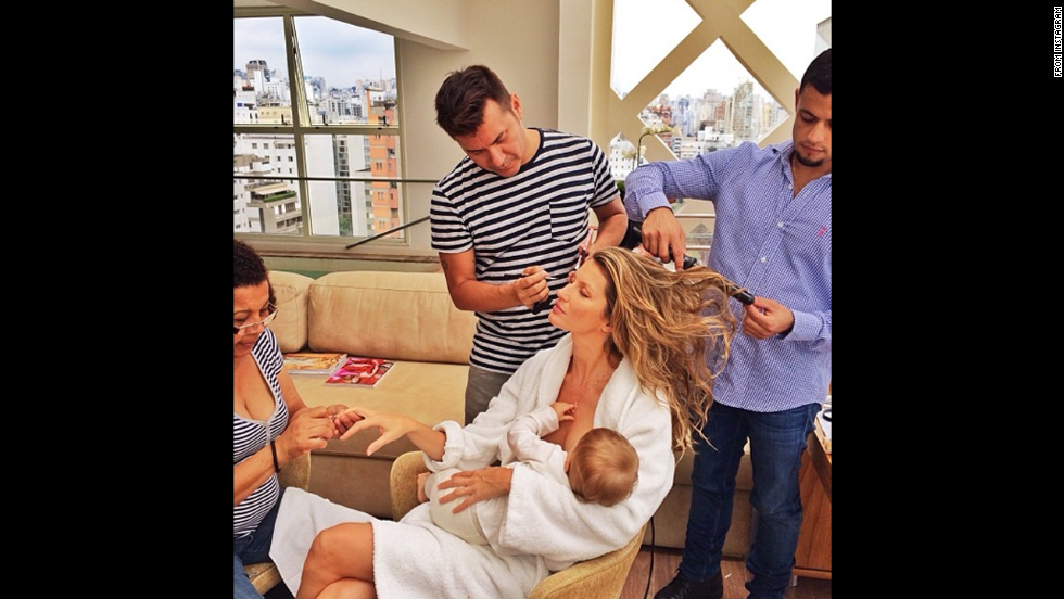 "Supermodel Gisele Bundchen posted this image to her Instagram account, opening up a dialog about whether she was representing a <a href=""http://www.cnn.com/video/data/2.0/video/us/2013/12/11/nr-gisele-bundchen-breastfeeding-instagram.cnn.html"">glamorized version of motherhood</a>.  ""What would I do without this beauty squad after the 15 hours flying and only 3 hours of sleep #multitasking #gettingready,"" <a href=""http://instagram.com/p/hvz4wzntH_/ "" target=""_blank"">she wrote</a>. Famous moms haven't been shy about sharing images of themselves breastfeeding. Click through the gallery for more examples."