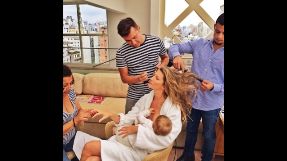 "Supermodel Gisele Bundchen posted this image to her Instagram account, opening up a dialog about whether she was representing a glamorized version of motherhood.  ""What would I do without this beauty squad after the 15 hours flying and only 3 hours of sleep #multitasking #gettingready,"" she wrote. Famous moms haven"