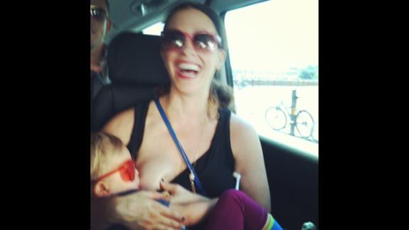 "Singer Alanis Morissette posted this more down to earth photo of herself breastfeeding her son Ever while on tour. Her message: ""family on tour ;) europe 2012 #worldbreastfeedingweek #isupportyou."""