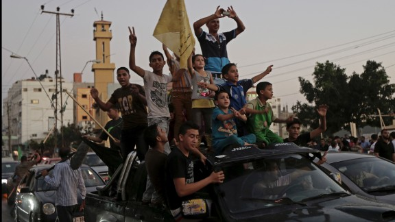 Palestinians in Gaza celebrate a ceasefire between Israel and Hamas on Tuesday, August 26. After more than seven weeks of heavy fighting, Israel and Hamas agreed to an open-ended ceasefire that puts off dealing with core long-term issues.