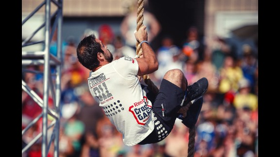 Froning does a rope climb during the Thick N' Quick event. Athletes had to do four rope climbs and three overhead squats with 165 pounds in under 4 minutes.