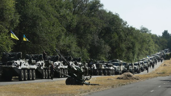 Ukrainian soldiers stop on a roadside as they wait for the start of their march into Mariupol on Wednesday, August 27.