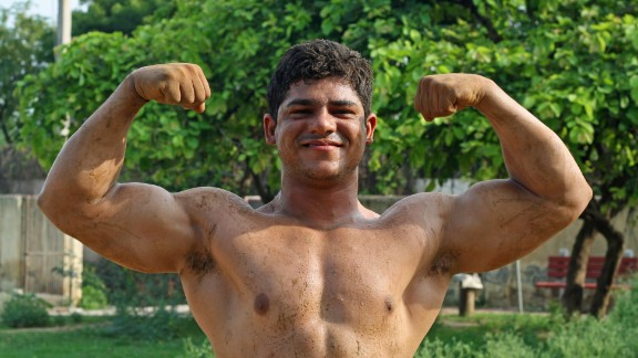 """Sonu, 19, wakes up at 5 a.m. every morning to train. He hopes to be a """"great wrestler."""""""
