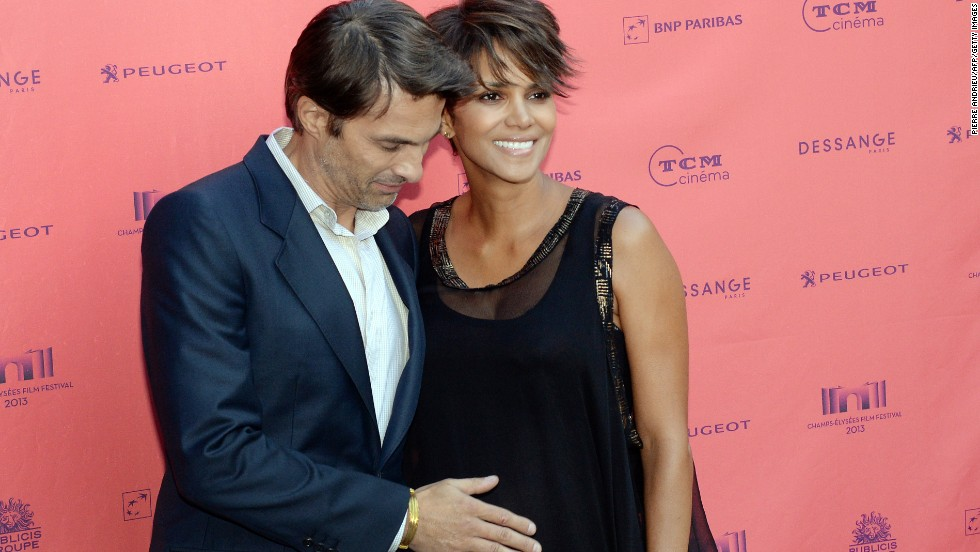 "The world knew that Halle Berry was planning to marry French actor Olivier Martinez <a href=""http://marquee.blogs.cnn.com/2012/03/12/halle-berry-olivier-martinez-officially-engaged/?iref=allsearch"" target=""_blank"">as of March 2012</a> -- when Martinez himself let the news slip -- but <a href=""http://marquee.blogs.cnn.com/2012/04/17/halle-berry-on-engagement-never-say-never/?iref=allsearch"" target=""_blank"">Berry didn't talk about it until weeks later</a>. The couple's moves toward the altar were closely tracked, which meant that even though they didn't talk about it, we still knew they were <a href=""http://www.cnn.com/2013/07/14/showbiz/halle-berry-marriage/index.html?iref=allsearch"" target=""_blank"">tying the knot in a private affair in France in July 2013.</a>"