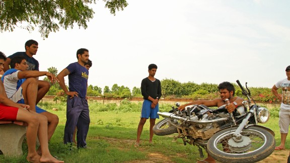 To train, the men lift motorcycles weighing 300 kilograms (about 660 lbs).