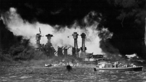 A view of U.S. ships in Pearl Harbor, Hawaii, after the Japanese attack on December 7, 1941. The USS West Virginia and USS Tennessee are in the foreground. The attack destroyed more than half the fleet of aircraft and damaged or destroyed eight battleships. Japan also attacked Clark and Iba airfields in the Philippines, destroying more than half the U.S. Army