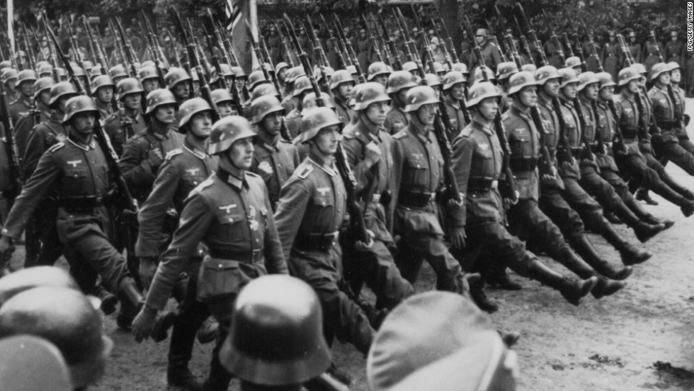 German troops march through occupied Warsaw, Poland, after invading the nation on September 1, 1939, and igniting World War II.