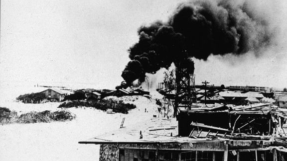 Black smoke rises from demolished buildings after Japanese air forces attacked the U.S. Navy base on Midway Atoll during the Battle of Midway in June 1942. The four-day battle became a major victory for the U.S. Navy, which sunk four Japanese aircraft carriers, and it marked a turning point in the war in the Pacific.