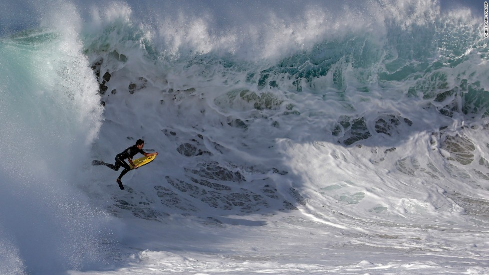 "A bodyboarder rides a wave at the wedge in Newport Beach, California, on Wednesday, August 27. Southern California beachgoers experienced <a href=""http://www.cnn.com/video/data/2.0/video/us/2014/08/27/malibu-big-waves-orig-cfb.cnn.html"">higher than normal surf</a>, brought on by Hurricane Marie off the coast of Mexico."