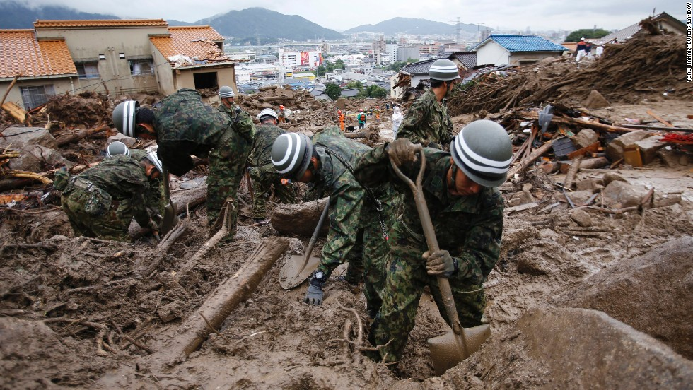 "Japanese soldiers search for survivors on Friday, August 22, after <a href=""http://www.cnn.com/2014/08/20/asia/gallery/hiroshima-landslide/index.html"">rain triggered massive landslides</a> Wednesday that swallowed up dozens of homes in Hiroshima, Japan."