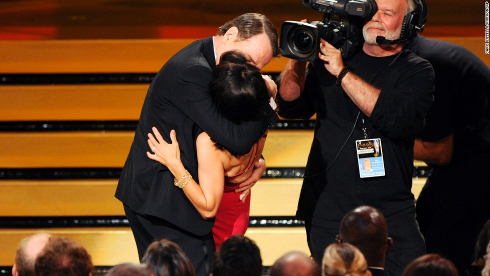 "Bryan Cranston kisses Julia Louis-Dreyfus as she accepts the award for outstanding lead actress in a comedy series for her work on ""Veep"" at the <a href=""http://www.cnn.com/2014/08/26/showbiz/gallery/emmy-moments-2014/index.html"">66th Primetime Emmy Awards</a> in Los Angeles on Monday, August 25. ""It was pretty good,"" Louis-Dreyfus later said backstage. ""He went for it. He goes for it in everything he does."""