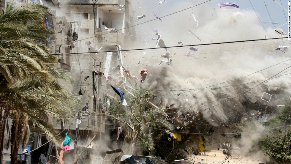 Smoke rises after Israeli aircraft hit a house in the Al-Shati refugee camp in Gaza on Sunday, August 24.