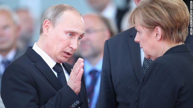 Caption:OUISTREHAM, FRANCE - JUNE 06: Russian President Vladimir Putin chats to German Chancellor Angela Merkel as they attend a Ceremony to Commemorate D-Day 70 on Sword Beach on June 6, 2014 in Ouistreham, France. Friday 6th June is the 70th anniversary of the D-Day landings which saw 156,000 troops from the allied countries including the United Kingdom and the United States join forces to launch an audacious attack on the beaches of Normandy, these assaults are credited with the eventual defeat of Nazi Germany. A series of events commemorating the 70th anniversary are planned for the week with many heads of state travelling to the famous beaches to pay their respects to those who lost their lives. (Photo by Chris Jackson/Getty Images)