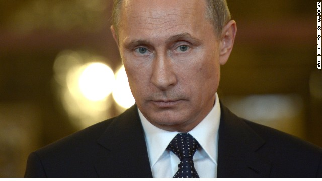 Caption:Russia's President Vladimir Putin looks on while speaking with journalists in Itamaraty Palace in Brazilia, early on July 17, 2014. The United States and Europe strengthened sanctions on Moscow over Ukraine yesterday, with President Barack Obama taking his first direct swipes in the finance, military and energy sectors of the Russian economy. Putin warned the biting sanctions will boomerang and hit back at US national interests, will inflicting 'very serious damage' on an already tattered US-Russia relationship. AFP PHOTO / RIA-NOVOSTI / POOL / ALEXEI NIKOLSKY (Photo credit should read ALEXEI NIKOLSKY/AFP/Getty Images)