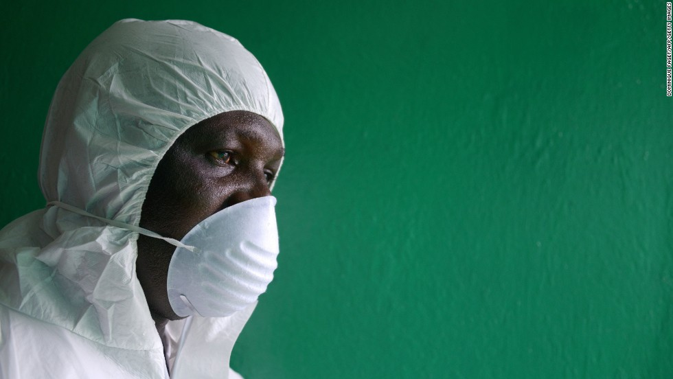 A health worker wearing a protective suit conducts an Ebola prevention drill at the port in Monrovia on August 29, 2014.