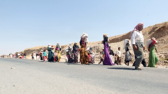 Displaced Iraqi families from the Yazidi community cross the Iraqi-Syrian border at the Fishkhabur crossing to safety, in northern Iraq, on August 13, 2014.