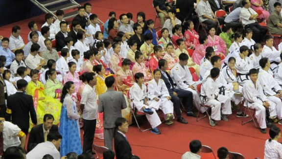 North Korean dance and tae kwon do students prepare to perform for the crowd of 13,000 at the wrestling festival.