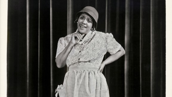 """Considering the early trials Jackie """"Moms"""" Mabley had to overcome, her enduring and groundbreaking career in comedy is all the more impressive. After starting off in vaudeville in 1920s New York, she expanded to the silver screen and became the first female comedian to perform at the Apollo Theater. Before Phyllis Diller put on her fright wig and sack dress, Mabley was making audiences double over with her bawdy sense of humor that included frank talk about race. Mabley's talent wasn't widely recognized until the '60s; she died in 1975."""