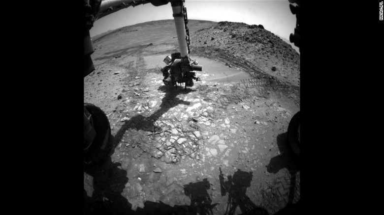 """This image shows the Curiosity rover doing a test drill on a rock dubbed """"Bonanza King"""" to see if it would be a good place to dig deeper and take a sample. <a href=""""https://www.nasa.gov/mission_pages/msl/index.html"""" target=""""_blank"""">Curiosity was launched in 2011</a>, and it is the most advanced rover ever built. It's helping scientists determine whether Mars is, or ever was, habitable for life forms."""
