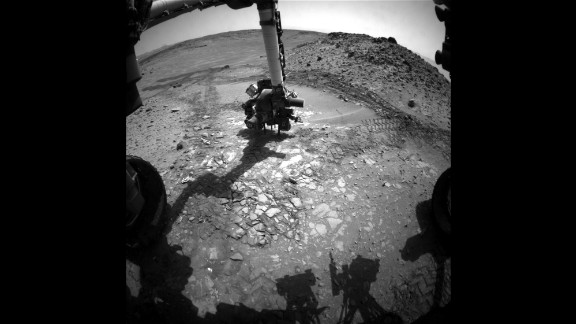 "This image shows the Curiosity rover doing a test drill on a rock dubbed ""Bonanza King"" to see if it would be a good place to dig deeper and take a sample. Curiosity was launched in 2011, and it is the most advanced rover ever built. It's helping scientists determine whether Mars is, or ever was, habitable for life forms."