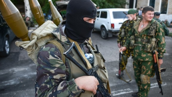 Pro-Russian rebels prepare arms for the the assault on the positions of Ukrainian army in Donetsk airport, eastern Ukraine, Sunday, Aug. 31, 2014.