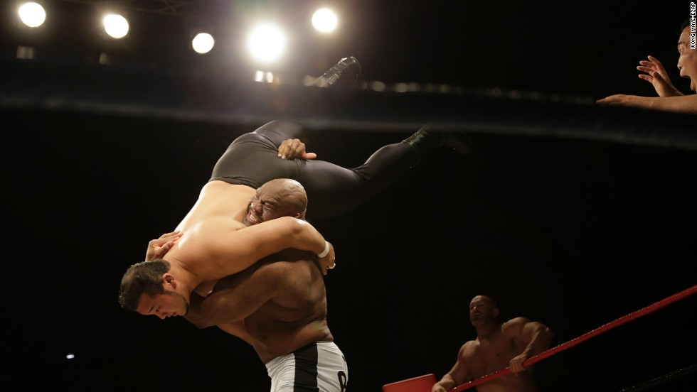 "Bob ""The Beast"" Sapp lifts his opponent during a pro wrestling match held Saturday, August 30, in Pyongyang, North Korea. The exhibition, put together by Japanese pro wrestling legend Antonio Inoki, was <a href=""http://www.cnn.com/2014/08/31/world/asia/north-korea-ripley-wrestling/index.html"">the first pro wrestling event North Korea has seen in almost 20 years.</a>"
