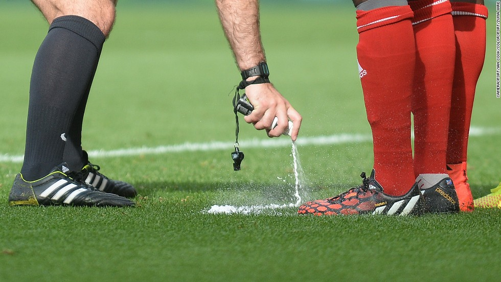 "Referee Paul Tierney uses vanishing spray to mark the 10-yard line for a free kick Saturday, August 30, during a Premier League match between Swansea City and West Bromwich Albion in Swansea, Wales. The spray is being used in the league <a href=""http://www.cnn.com/2014/07/31/sport/football/football-vanishing-spray-english-premier-league/index.html"">for the first time</a> this season."
