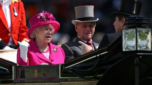 The royal couple arrives at the Royal Ascot horse races in June 2014.