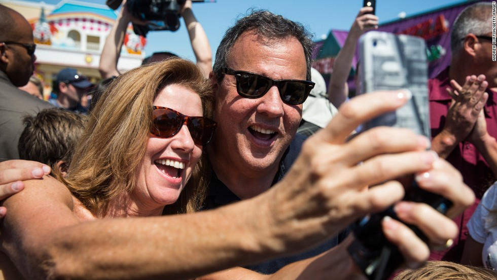 New Jersey Gov. Chris Christie takes a selfie with a woman while touring the boardwalk in Point Pleasant, New Jersey, on Friday, August 29. Christie was there taking questions from reporters and commenting on the state's recovery from Hurricane Sandy.
