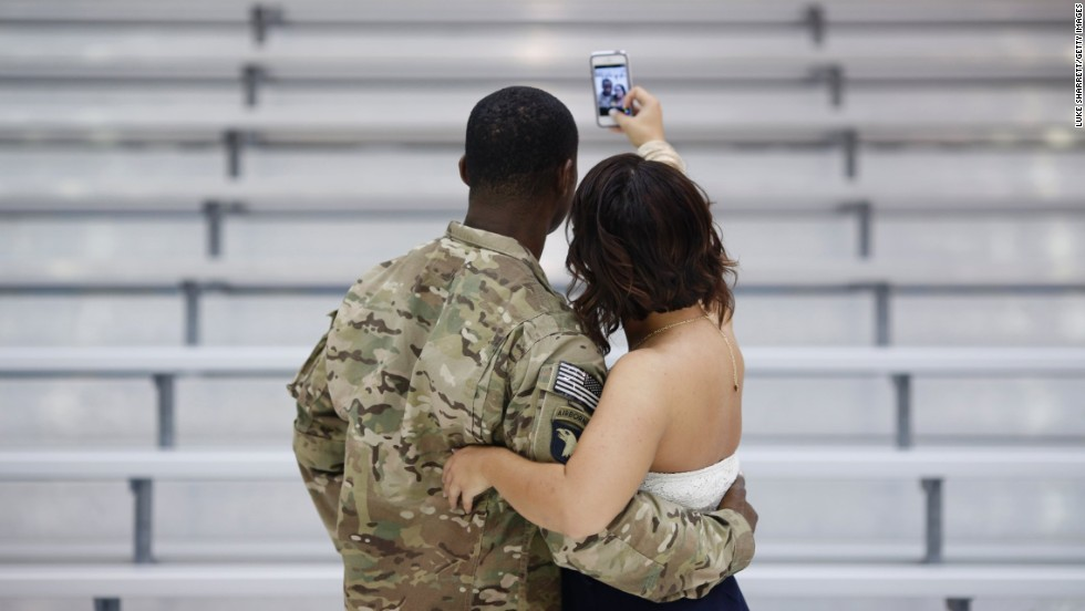 Army Sgt. 1st Class Craig Cooper takes a selfie with his girlfriend, Ashley Zeigler, following a homecoming ceremony in Fort Campbell, Kentucky, on Monday, September 1. About 20 soldiers returned to Fort Campbell following a nine-month deployment in Afghanistan.