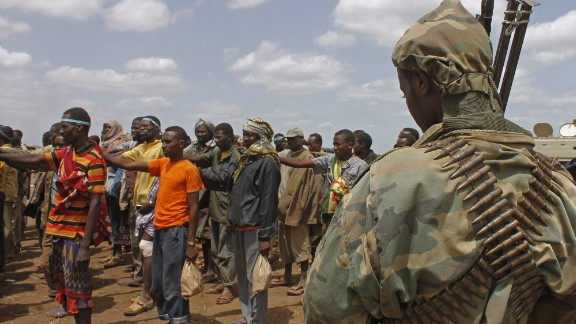 [File] Photo taken on September 22, 2012 shows members of  Al-Shabaab giving themselves up to AU peacekeepers in Somalia.